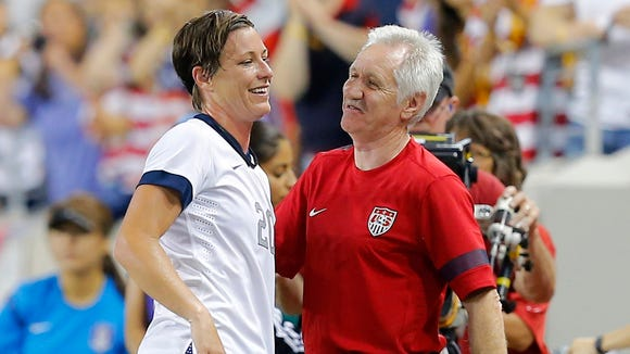 Jun 20, 2013; Harrison, NJ, USA; USA head coach Tom Sermanni and forward Abby Wambach (20) during the second half against the Korea Republic at Red Bulls Arena. USA defeats the Korea Republic 5-0. Mandatory Credit: Jim O'Connor-USA TODAY Sports