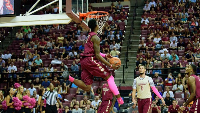 Jarquez Smith (23) goes for a slam dunk during the Jam with Ham event,
