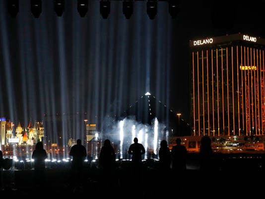 Fifty-eight lights are on display for the 58 victims of the Las Vegas shooting during a ceremonial groundbreaking for the Oakland Raiders' stadium Monday, Nov. 13, 2017, in Las Vegas. After years of planning, dealing and getting millions in public financing approved, the Oakland Raiders broke ground Monday on a 65,000-seat domed stadium in Las Vegas, across the freeway from the city's world-famous casinos. (AP Photo/John Locher)