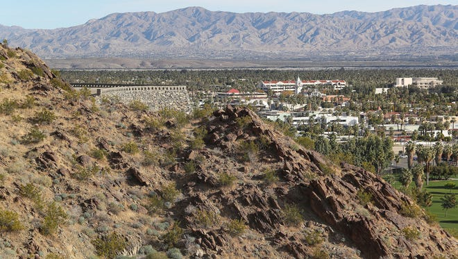 This undeveloped mountainside above Palm Springs, including a stone wall and a leveled area of land, may be turned into high-end homes near the O'Donnell Golf Course.