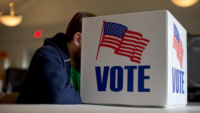A voter fills our a provisional ballot by hand for the midterm elections at a polling place in Annapolis, Md., Tuesday, Nov. 4, 2014. (AP Photo/Carolyn Kaster) ORG XMIT: MDCK101