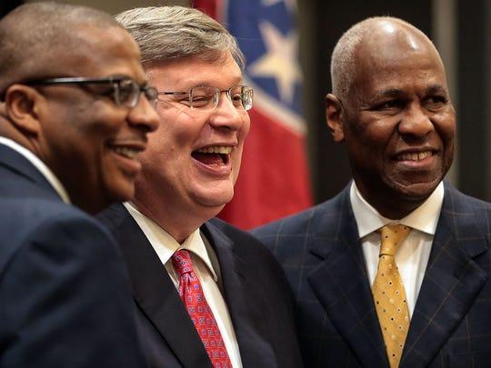 Memphis Mayor Jim Strickland (center) talks with former
