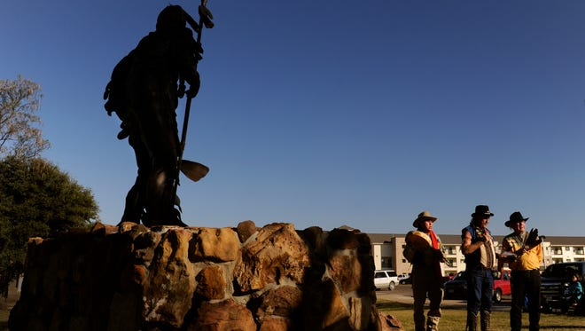 Don Parker, Paul Davis and Bruce Parker face west as they begin a Comanche blessing of a statue of Quanah Parker at Western Texas College in Snyder on Nov. 1.. Both Parkers are descendants of Quanah Parker, who roamed the area 150 years ago.
