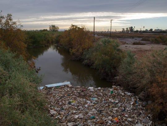Debris is caught in the New River near the U.S.-Mexico