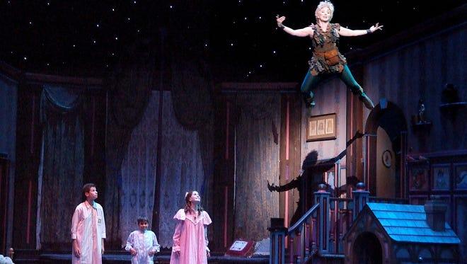 "Micah Meyers, Luke Pryor, Sarah Miller-Crews and Carly Bracco in ""Peter Pan."""
