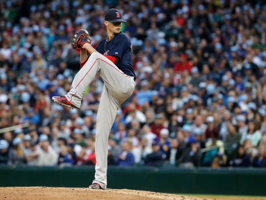 Boston Red Sox starting pitcher Clay Buchholz winds up in the fourth inning of a baseball game against the Seattle Mariners, Friday, May 15, 2015, in Seattle. (AP Photo/Ted S. Warren)