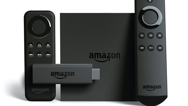 Amazon's Fire TV, a streaming device, and the voice-controlled remote that comes with it. Also pictured, the Fire TV Stick.