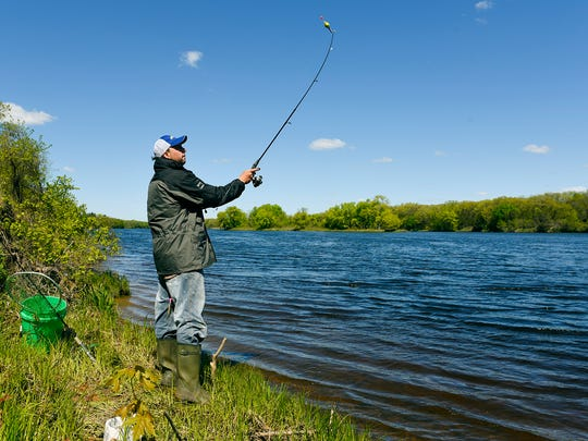 Jason Power, Albany, casts as he fishes along the bank of the Mississippi River Sunday, May 15, near the boat access at Mississippi River County Park.