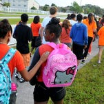 Wednesday was National Walk your Child to School Day. Faculty, students ands parents from Stone Middle School participated in the event  walking from Babcock St. to the school down University Blvd with a Melbourne Police Escort.