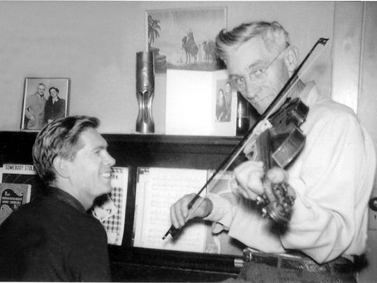 Johnnie Ray, left, jams with his father, Elmer Ray, on a visit to his parents home in the Fruitland area east of Salem.