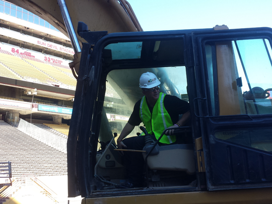 Todd Graham in an excavator.