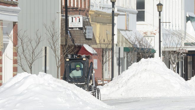 When snow and ice hits the area, as in this February 2015 storm, rock salt can cause pitting on concrete sidewalks. The city is looking at using other chemicals to melt the wintry mix.