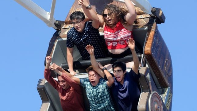 Jacob Ayala, front left, Adan Cruz and Steve Johnson, along with David Doan, in back at left, and Ximena Alvear, enjoy riding the Sea Dragon at the Ventura County Fair in 2016.