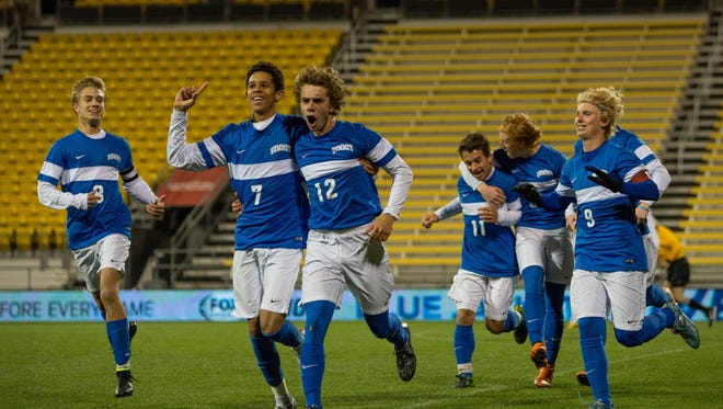 Summit Country Day players celebrate their first goal in the first half of their game Saturday evening. The Summit Country Day Silver Knights played in the Division III state finals November 14, 2015 against the South Range Raiders at MAPFRE Stadium in Columbus, OH.