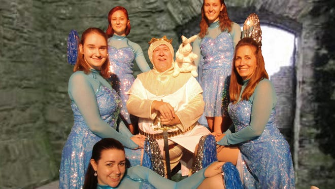 """King Arthur, played by Rob Dickman, enjoys the attention of the Laker Girls in Surfside Playhouse's production of """"Spamalot."""""""
