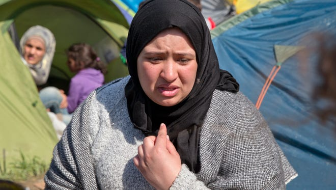 Insaf Haddad, 25 years-old, speaks during an interview with the Associated Press at a camp in Idomeni, northern Greece, on the border with Macedonia, Thursday, March 3, 2016. Insaf Haddad said her family decided to head for Germany to rebuild their lives but they have been living in a tent near the railway tracks for two days and many others have been there for at least two weeks, and they are beginning to despair.  The fields on the outskirts of the small Greek village of Idomeni have become the flashpoint in Europe's massive refugee crisis, the size of which the continent has not seen since World War II.