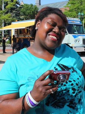Christina Pitman smiles during the Different Point of View photography project held in June 2016.