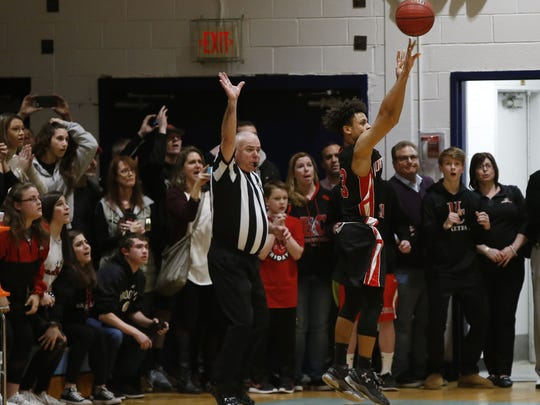 Anthony McDowell(13) of Hunterdon Central makes the game winning basket, defeating Freehold Twp. 41-39 during NJSIAA Central Group IV final at Freehold Twp. High School.