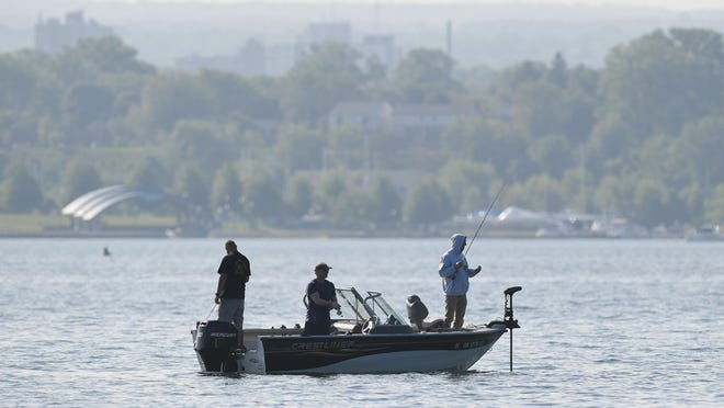 Fishermen work the waters of Presque Isle Bay near Parking Vista No. 1, June 5, 2020, near Presque Isle State Park.