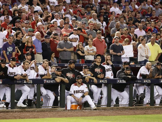 Diamondbacks players and coaches watch the ninth inning