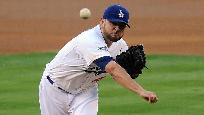 Los Angeles Dodgers starting pitcher Ricky Nolasco (47) pitches the first inning against the St. Louis Cardinals in Game 4 of the National League Championship Series baseball game at Dodger Stadium.