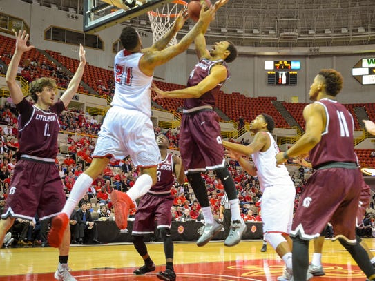 UL's Shawn Long (21) works under the basket in Saturday's