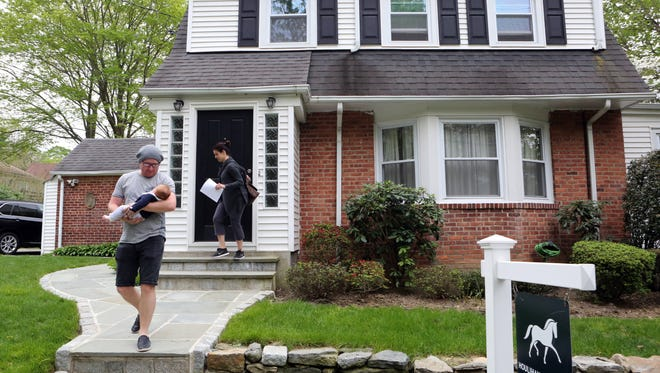 House hunters John and Ashley Birchall of Irvington, with their 10-week-old daughter Charli, leave an open house in Ardsley April 30, 2017. The three-bedroom, two-bath Colonial, priced at $589,000, just came on the market.