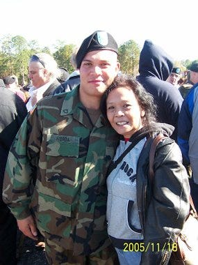 Casimir Werda, seen here with his mother, graduates boot camp in 2005.