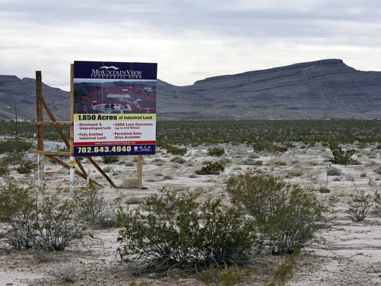 A sign notes the spot in the desert north of Las Vegas