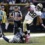 Saints running back C.J. Spiller, right, runs for the game-winning touchdown in overtime against the Cowboys on Sunday in New Orleans.