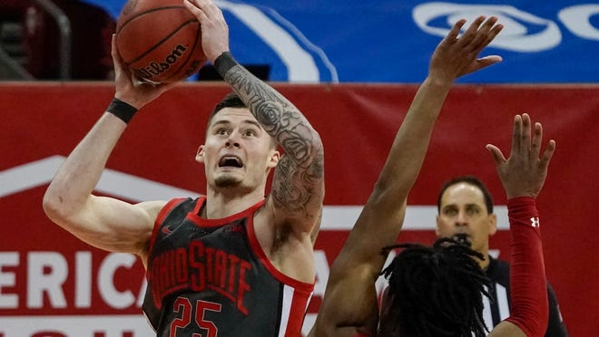 Ohio State's Kyle Young shoots over Wisconsin's Aleem Ford during the second half of an NCAA college basketball game Saturday, Jan. 23, 2021, in Madison, Wis. (AP Photo/Morry Gash)