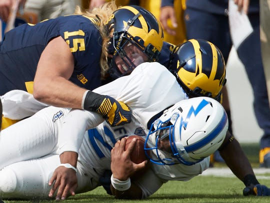 Sep 16, 2017; Ann Arbor, MI, USA; Air Force quarterback Arion Worthman is tackled by Michigan defensive end Chase Winovich (15) in the first half at Michigan Stadium.