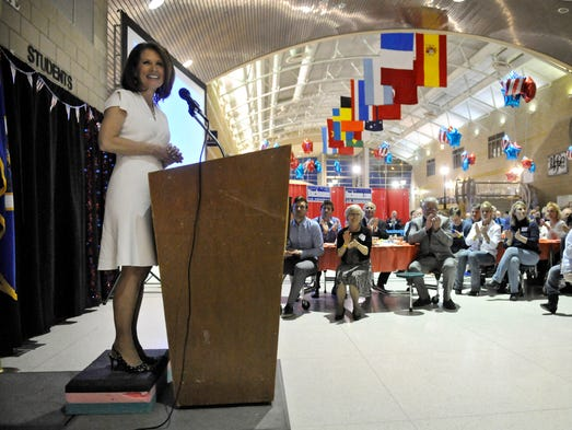 U.S. Rep. Michele Bachmann begins her speech during a Sixth Congressional District tribute event Friday at Monticello High School.
