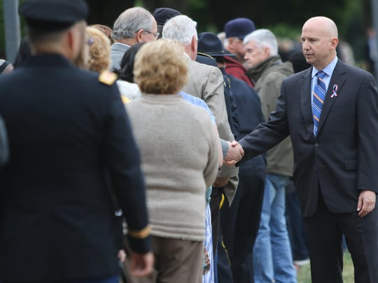 Gov. Jack Markell greets members of the public as they wait in line to pay their respects to Beau Biden on Thursday at Legislative Hall in Dover.