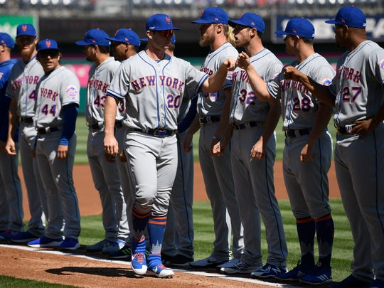 New York Mets' Pete Alonso (20) greets teammates during player introductions before a baseball game against the Washington Nationals, Thursday, March 28, 2019, in Washington. (AP Photo/Nick Wass)