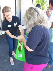 Meg Buckley providing food at a mobile food pantry.