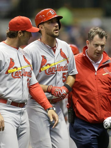 Adam Wainwright is helped off the field in the fifth