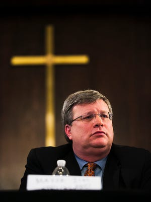 July 11, 2016 - Mayor Jim Strickland listens to a speaker address an issue during a Black Lives Matter town hall meeting with Memphis Police Department Interim Director Michael Rallings and himself at Greater Imani Church on Monday. BLM organizers hoped the meeting would help usher in change to Memphis. The goal of the meeting was to explore options to improve relationships between the community and police, ensure equal protection under the law, and locate resources and programming to positively impact the African-American community.
