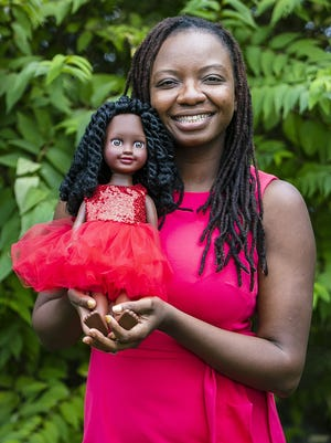 Fusion Dolls creator Widline Pyrame of Brockton poses for a portrait with her best selling doll Angel at D.W. Field Park in Brockton on Tuesday, Sept. 29, 2020. Pyrame created Fusion dolls after her own experiences with self-esteem struggles growing up with dolls that didn't look like her. Fusion Dolls' mission is to spread diversity, awareness, and encourage children to love themselves inside out.