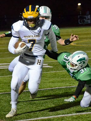 Reece Potter (7) and his Hartland teammates will host Howell Friday night.