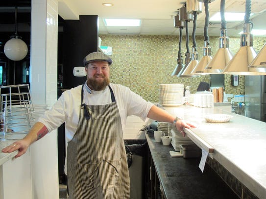 Executive Chef Andy Hunter is in a kitchen during The