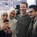 Facebook CEO and cofounder Mark Zuckerberg takes a selfie at Facebook headquarters in Menlo Park, CA.
