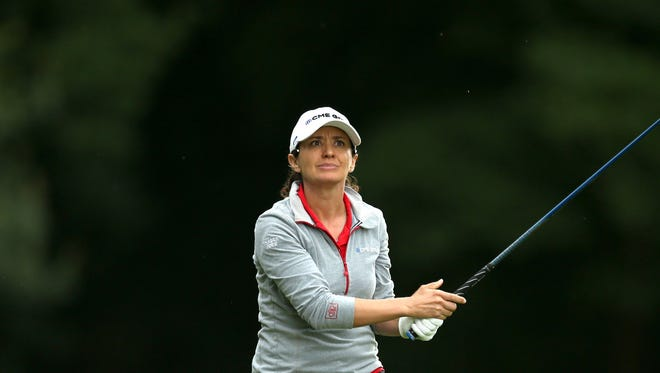 Naples' Mo Martin in action during day four of the Women's British Open at Woburn Golf Club in Woburn, England, Sunday, July 31, 2016. The Women's British Open was established by the Ladies' Golf Union in 1976 and was intended to serve as the women's equivalent of The Open Championship. (Steve Paston/PA via AP)