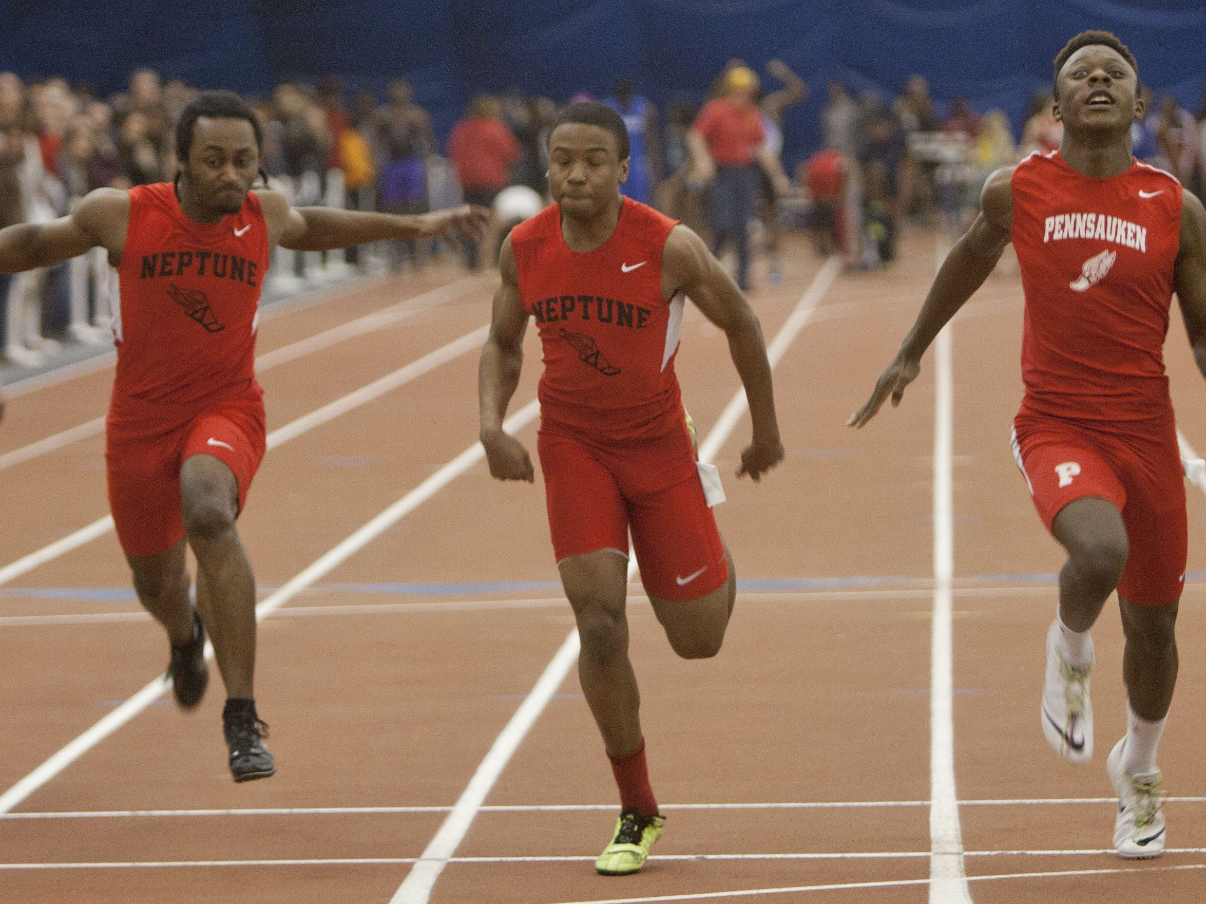 Marvin Morgan (center), shown here finishing second in the NJSIAA Group III 55-meter dash indoors in Feb., won the Central Group III 100-meter dash on Friday afternoon at Northern Burlington