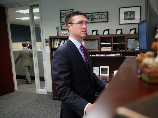 Luke Chapman, a partner at Swarthmore Financial Services, reviews investments in his office.
