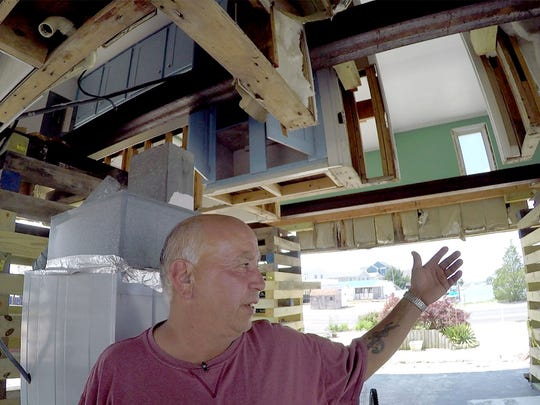 Little Egg Harbor resident Edwin Byk stands below his lifted home on East Navesink Drive Monday, June 12, 2016.  He decided to elevate his home after it was flooded with more than three feet of water during superstorm Sandy, but unfortunately his contractor, J&N, elevated the house (without permits) and then left, leaving Edwin in the lurch.