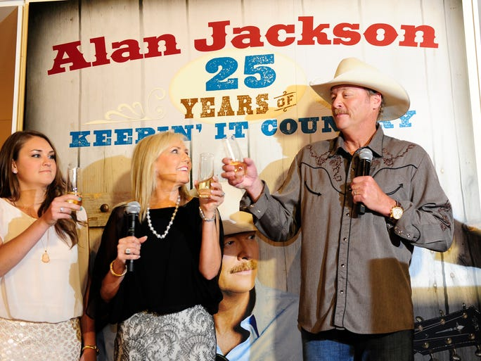Alan Jackson was with his wife, Denise, and daughter Mattie celebrate during the opening party for Jackson's exhibit at the Country Music Hall of Fame and Museum in commemoration of his 25 years in country music.