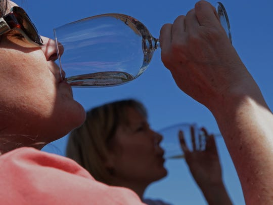 Customers sample wines at Brys Estate Vineyard & Winery located on the Old Mission Peninsula in Traverse City in 2013.