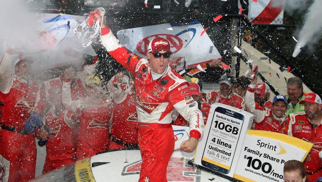 NASCAR Sprint Cup Series driver Kevin Harvick celebrates in victory lane after winning the AAA 400 at Dover International Speedway.