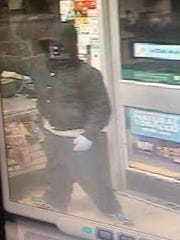 A surveillance photo of a man suspected on two convenience stores armed robberies north Reno.